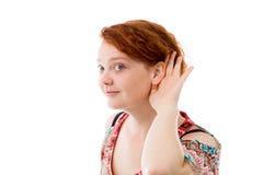 Model isolated on plain background listening Stock Photo
