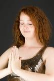 Model isolated on plain background praying wishing Stock Images