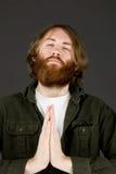 Model isolated on plain background praying wishing Royalty Free Stock Photography