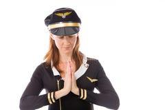 Model isolated on plain background praying wishing Royalty Free Stock Image