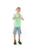 Model isolated on plain background praying wishing Royalty Free Stock Photos