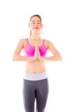 Model isolated on plain background praying wishing Stock Image