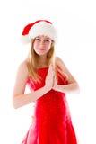 Model isolated on plain background praying wishing Stock Photography