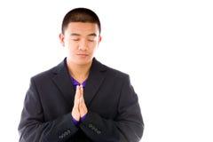 Model isolated on plain background praying wishing Royalty Free Stock Images