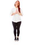 Model isolated on plain background praying wishing Stock Photo