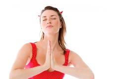 Model isolated on plain background praying wishing. Model in studio isolated on white background Stock Photography