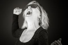Model isolated on plain background screaming Stock Images