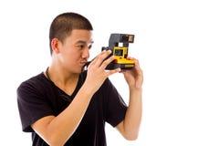 Model isolated on white camera polaroid Stock Photography