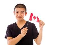 Model isolated on white holding canadian flag Royalty Free Stock Photo