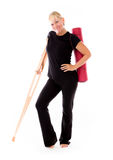 Model isolated on white injured with crutch Stock Photography