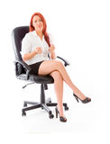 Model isolated on white in an office chair Royalty Free Stock Photos