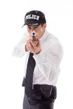 Model isolated on white policeman with gun Royalty Free Stock Photos