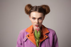 Model in jacket with flowe Royalty Free Stock Image