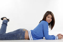 Model in jeans. Young girl posing in jeans Stock Photography