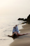 Model in jeans by the sea Stock Images