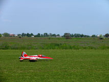 Model of a jet airplane on the remote control. Just landed on the grass Royalty Free Stock Images