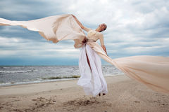 Model jumps with long dress l Stock Image