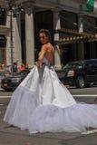 Model Kalyn Hemphill crossing the street in front of Plaza hotel at the Irina Shabayeva SS 2016 Bridal shoot Stock Photo