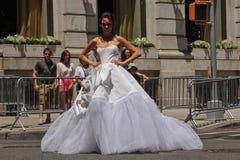 Model Kalyn Hemphill crossing the street in front of Plaza hotel at the Irina Shabayeva SS 2016 Bridal shoot Royalty Free Stock Image