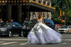 Model Kalyn Hemphill crossing the street in front of Plaza hotel at the Irina Shabayeva SS 2016 Bridal shoot Royalty Free Stock Photos