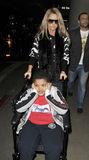 Model Katie Price aka Jordan with son LAX airport Royalty Free Stock Image