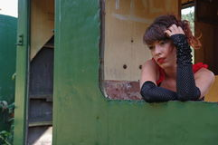 Model lady at the window of an abandoned train royalty free stock photos