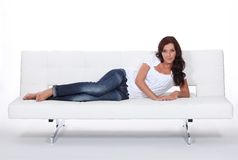 Model laid on expensive sofa Stock Photos