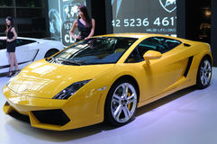 Model and  lamborghini, Gallardo LP 550-2 Coupe Royalty Free Stock Images