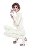 Model in latex catsuit. Model in beige latex catsuit with kitten over white background royalty free stock image