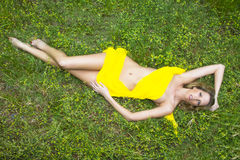 Model Laying in Field Stock Image