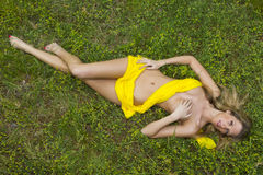 Model Laying in Field Royalty Free Stock Photos