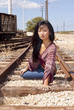 Model laying on Train Tracks. Pretty model laying on train tracks at the Hawaiian Railway on Oahu stock photography