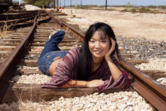 Model laying on Train Tracks. Model laying on railroad tracks at the Hawaiian railway royalty free stock photos