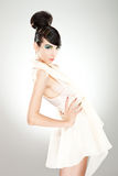 Model leaning back with hand on waist Royalty Free Stock Photos