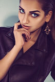 Model in leather jacket with healthy skin and make up. In studio Stock Images