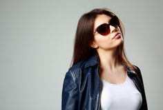 Model in leather jacket and sunglasses Stock Photography