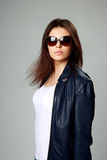 Model in leather jacket and sunglasses Stock Images