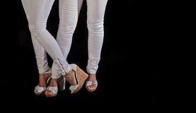 Model legs, high heels and white tight pants Royalty Free Stock Photo