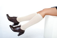 Model legs wearing in fashion shoes and half-hose Stock Images
