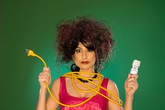Model with Light Bulb. And extension chord on a green background Stock Photo