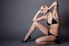 Model in lingerie sitting Stock Images