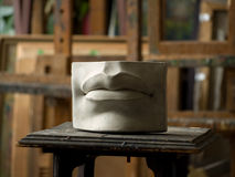 Model of lips. Gypsum model of lips in painting studio interior stock photos