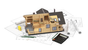 The model of a log house on the background drawings with drawing instruments. The three-dimensional image of a modern wooden house on a background of drawings Stock Photos