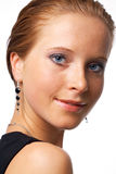 Model Loking at You. Close-up portrait of a young model, posing over white Royalty Free Stock Image