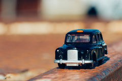 Model of a London Taxi. A model London Taxi parked on a rusted steel beam Stock Photography