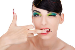 Model with long fancy nails showing middle finger Royalty Free Stock Images