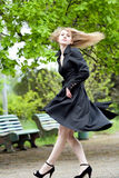 Model with long flying hair in park Royalty Free Stock Photo