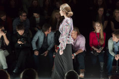 Model in a long gray skirt on Mercedes-Benz Fashion Week Stock Photo