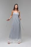 Model in long grey lace nighty standing in studio Royalty Free Stock Photos