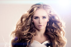 Model with long hair Blonde Waves Curls Hairstyle Hair Salon Updo Fashion model with shiny hair Woman with healthy hair girl with stock images
